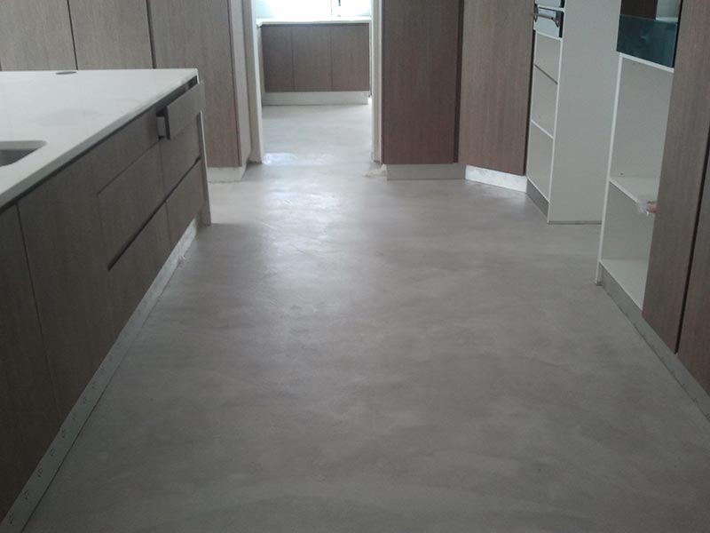 decorative-grey-concrete-overlay-open-plan-kitchen