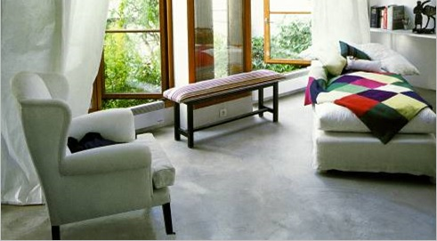 living room area with stained concrete floors