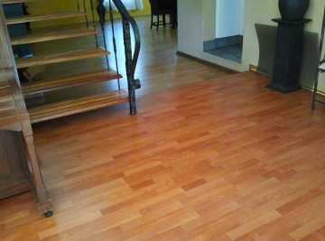 cement floor with pine wood laminate