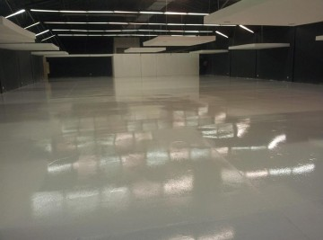 white epoxy flooring showroom